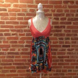 Bebe Knit/pattern silk mini dress w/bubble hem.